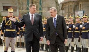 Turkish President Recep Tayyip Erdogan, right, and Romanian President Klaus Iohannis review an honor guard at the Cotroceni presidential palace in Bucharest, Romania, Wednesday, April 1, 2015. Two members of a banned leftist group and a prosecutor they held hostage inside a courthouse in Istanbul died Tuesday after a shootout between the hostage takers and police, officials said. Erdogan is on an official visit to Romania. (AP Photo/Vadim Ghirda)