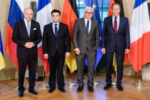 French Foreign Minister Laurent Fabius, Ukrainian Foreign Minister Pavlo Klimkin, German Foreign Minister Frank-Walter Steinmeier and Russian Foreign Minister Sergey Lavrov, from left, pose for a group photo at Villa Borsig, the official guest house of the foreign ministry, in Berlin on Monday, April 13, 2015 before their meeting to discuss implementation of the peace agreement brokered in Minsk, Belarus in February.  (Clemens Bilan/Pool Photo via AP)