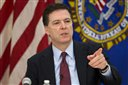 FILE - This is a Wednesday, March 25, 2015  file photo of FBI director James Comey as he gestures during a news conference at FBI headquarters in Washington.  FBI director Comey  has caused huge offense to a U.S. ally: using language to suggest that Poles were accomplices in the Holocaust. On Monday, April 20, 2015  Poles were waiting to see if FBI director James Comey apologizes _ something Polish Foreign Minister Grzegorz Schetyna said he expected so the matter can be settled. (AP Photo/ Evan Vucci, File)