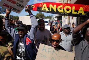 People march against immigrant attacks in South Africa, in Cape Town, South Africa, Wednesday, April 22, 2015. Police officers and soldiers raided a hostel considered a hotspot for anti-immigrant attacks in downtown Johannesburg as South Africa continued a crackdown in xenophobic violence. (AP Photo/Schalk van Zuydam)