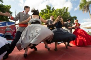 """Descendants of American Southerners wearing Confederate-era dresses and uniforms dance during a party to celebrate the 150th anniversary of the end of the American Civil War in Santa Barbara d'Oeste, Brazil, Sunday, April 26, 2015. For many of the residents of Santa Barbara d'Oeste and neighboring Americana, in Brazil's southeastern Sao Paulo state, having Confederate ancestry is a point of pride and is celebrated in high style at the annual """"Festa dos Confederados,"""" or """"Confederates Party"""" in Portuguese. (AP Photo/Andre Penner)"""