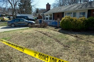 The damaged car of the Preston Hall family sits in their driveway on Cindy Lane in Annandale, Va., Tuesday, March 31, 2015, near Inova Fairfax Hospital. A prisoner who escaped with a gun from the hospital and carjacked a car with a woman inside, crashed the stolen car into Hall's wife's car, at right, after driving across their front yard.  (AP Photo/Cliff Owen)