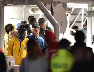 Survivors of the boat that overturned off the coasts of Libya Saturday, wait to disembark from Italian Coast Guard ship Bruno Gregoretti, at Catania Harbor, Italy, Monday, April 20, 2015. A smuggler's boat crammed with hundreds of people overturned off Libya's coast as rescuers approached, causing what could be the Mediterranean's deadliest known migrant tragedy and intensifying pressure on the European Union Sunday to finally meet demands for decisive action. (AP Photo/Carmelo Imbesi )