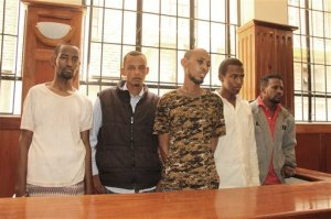 Kenyan police present in a Nairobi court  Tuesday, April 7, 2015, five  suspects  arrested in connection with the Islamic extremist attack that killed over one hundred people at a university in Garissa northeastern Kenya last Thursday. The court granted police 30 more days to investigate the suspects before charging them in court. The five suspects who appeared in court were named as Mohammed Adan Surow, Osman Abdi Dakane, Mohammed Abdi Abikar, Hassan Aden Hassan and Sahal Diriye Hussien their was no left to right identification available . The police say the five supplied guns to the four gunmen who carried out the attack last week on Garissa University College . (AP Photo)