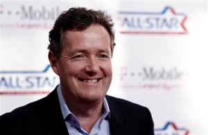 FILE - In this Sunday, Feb. 20, 2011 file photo, Piers Morgan arrives at the magenta carpet before the NBA basketball All-Star Game, in Los Angeles. Former CNN host Piers Morgan says he has been questioned by British police about tabloid phone hacking. Morgan, who edited Britain's Daily Mirror newspaper between 1995 and 2004, said he attended a voluntary interview with detectives on Tuesday, April 21, 2015. (AP Photo/Matt Sayles, file)