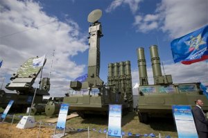 FILE - In this file photo taken on Tuesday, Aug.  27, 2013 a Russian air defense missile system Antey 2500, or S-300 VM, is on display at the opening of the MAKS Air Show in Zhukovsky outside Moscow. Russia has supplied similar systems to Syria. The Kremlin says Russia has lifted its ban on the delivery of a sophisticated air defense missile system to Iran. Russia signed the $800 million contract to sell Iran the S-300 missile system in 2007, but later suspended their delivery because of strong objections from the United States and Israel. The decree signed Monday, April 13, 2015, by President Vladimir Putin allows for the delivery of the missiles. (AP Photo/Ivan Sekretarev, File)