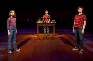 """This photo provided by O&M Co shows Sydney Lucas as Small Alison, Beth Malone as Alison, and Emily Skeggs as Medium Alison in """"Fun Home"""" at Circle in the Square Theatre in New York. """"Fun Home,"""" with a book and lyrics by Lisa Kron and music by Jeanine Tesori, played for four months at the off-Broadway Public Theater last year. It's been adapted from Alison Bechdel's graphic memoir about growing up in a funeral home with a closeted gay dad. (Joan Marcus via AP)"""