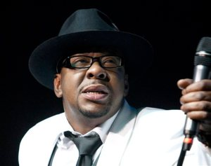 """FILE - In this Feb. 18, 2012 file photo, singer Bobby Brown, former husband of the late Whitney Houston performs with New Edition at Mohegan Sun Casino in Uncasville, Conn. Brown told concert goers Saturday, April 18, 2015, that his daughter Bobbi Kristina Brown is awake nearly three months after she was found face down and unresponsive in a tub at her Georgia home. In a video, Brown tells the crowd during a concert appearance at the Verizon Theatre in Dallas, Texas, that """"Bobbi is awake,"""" adding that """"she is watching me."""" The crowd screamed after his remark. (AP Photo/Joe Giblin, file)"""