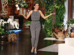 """In this March 16, 2015 photo released by Warner Bros., actress Bellamy Young, from the ABC series """"Scandal,"""" appears in a Max Mara black and cream sleeveless jumpsuit on """"The Ellen DeGeneres Show,"""" in Burbank, Calif. (Michael Rozman/Warner Bros. via AP)"""
