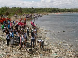 Environmental advocates, including Philippine Coast Guard and Miss Earth Philippines beauty candidates, conduct coastal clean-up along the shores of Freedom Island to mark World Earth Day Wednesday, April 22, 2015 at suburban Las Pinas, south of Manila, Philippines. The Freedom Island, which is home to about 80 species of local and migratory birds, is the receptacle of wastes, mostly plastics, that were washed ashore especially during rainy season. (AP Photo/Bullit Marquez)