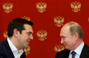 Russian President Vladimir Putin, right, and Greek Prime Minister Alexis Tsipras speak during a signing ceremony in the Kremlin in Moscow, Russia, Wednesday, April 8, 2015. Russian President Vladimir Putin said the leader of Greece did not ask for financial aid during an official visit, easing speculation that Athens might use its relations with Moscow to gain advantage in bailout talks with European creditors.  (AP Photo/Alexander Zemlianichenko, Pool)