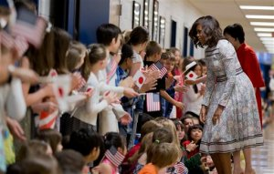 First Lady Michelle Obama and Akie Abe, wife of the Japanese Prime Minister Shinzo Abe, are welcomed by student at Great Falls Elementary School in Great Falls, Va., Tuesday, April 28, 2015, during a vist to the school and its Japanese immersion classes. The Japanese immersion is part of Virginia's Fairfax County Public School's World Languages Immersion Program, where elementary students learn math, science, and health through a foreign language. (AP Photo/Manuel Balce Ceneta)