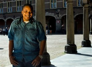 """In this April 16, 2015 photo, Jamaican Simone Edwards, who sought asylum abroad, poses for a portrait in the center of The Hague, Netherlands. In 2008, Edwards survived an attack by two gunmen who hissed the anti-gay epithet """"sodomite"""" at her as she lay bleeding on a street from two bullets. She later received asylum in the Netherlands and her story was told in the 2013 documentary """"The Abominable Crime."""" (AP Photo/Peter Dejong)"""