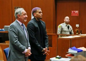 Chris Brown, right, appears with his attorney Mark Geragos, at a court hearing in the R&B singer's long-running case over his 2009 attack on Rihanna in Los Angeles on Friday, March 20, 2015. The judge closed Brown's assault case by revoking Brown's probation. (AP Photo/Mario Anzuoni, Pool)