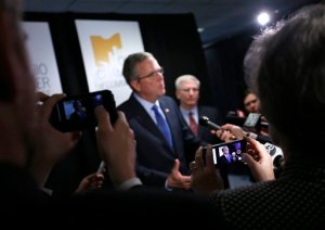 """Former Florida Gov. Jeb Bush answers questions from reporters following a speech at the annual meeting of the Ohio Chamber of Commerce, Tuesday, April 14, 2015, in Columbus, Ohio. The GOP White House prospect kicked off a speech in the battleground state with a series of personal recollections, saying he's his """"own person."""" (Jonathan Quilter/The Columbus Dispatch via AP)"""