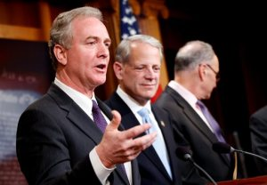 FILE - In this March 25, 2015, file photo, Rep. Chris Van Hollen, D-Md., ranking member on the House Budget Committee, left, speaks during a news conference on Capitol Hill in Washington to discuss the budget as  Rep. Steve Israel, D-N.Y., Sen. Charles Schumer, D-N.Y., listen. Cuts to Medicare and the health care law and almost $40 billion in unrequested money for overseas war-fighting operations top the agenda as congressional negotiators meet Monday, April 20 to begin ironing out a Republican budget blueprint for next year and beyond.  (AP Photo/Andrew Harnik, File)