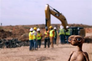 """FILE - In this April 26, 2014 file photo, an E.T. doll is seen while construction workers prepare to dig into a landfill in Alamogordo, N.M. A documentary on Atari's decline and a decades-old urban legend on the secret dumping of the """"E.T."""" game in the New Mexico desert is airing on Netflix. """"Atari: Game Over"""" was released on the streaming service late Wednesday, April 1, 2015, and details the demise of gaming giant Atari.  (AP Photo/Juan Carlos Llorca, File)"""