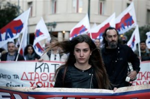 Members of the PAME Communist-affiliated union demonstrate against a decree by Greece's radical left-led government that forces state entities, including hospitals, municipalities and universities, to lend their reserves to the cash-strapped state, in central Athens on Friday, April 24, 2015. Parliament was debating a law retroactively approving the decree later Friday. (AP Photo/Petros Giannakouris)