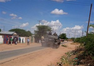 A Kenya Defence Forces tank moves towards the Garissa University college, in Garissa, Kenya, Thursday, April 2, 2015. Al-Shabab gunmen attacked Garissa University College in northeast Kenya early Thursday, targeting Christians and killing at least 15 people and wounding 60 others, witnesses said. (AP Photo)
