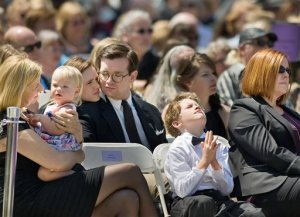 Hundreds of family and friends, including Samual Milner, front, take part in the memorial services for the late televangelist Rev. Robert H. Schuller, Monday, April 20, 2015, in Garden Grove, Calif. Schuller who founded the Crystal Cathedral was 88 when he died on April 2 after a battle with esophageal cancer. (Mindy Schauer/The Orange County Register via AP)   MAGS OUT; LOS ANGELES TIMES OUT
