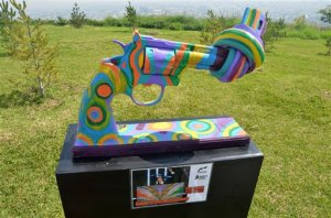 In this Thursday April 2, 2015 photo, a knotted gun sculpture painted by British musician and ex-Beatle Sir Paul McCartney is displayed at a park in the city of Monterrey, Mexico. Thirteen knotted gun sculptures painted by various artists are on display in this city that for years has been plagued with violence generated by warring drug cartels. The original knotted gun sculpture was designed and created by Carl Fredrik Reutersward as a memorial to John Lennon after he was shot and killed in 1980 and is now displayed outside of the United Nations headquarters in New York City.