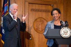 Vice President Joe Biden applauds as Loretta Lynch speaks at the Justice Department in Washington, Monday, April 27, 2015, after  Biden administered the oath of office to Lynch  as the 83rd Attorney General of the U.S. (AP Photo/Andrew Harnik)