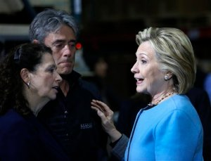 Democratic presidential candidate Hillary Rodham Clinton meets with employees at Whitney Brothers during a campaign stop, Monday, April 20, 2015, in Keene, N.H. (AP Photo/Jim Cole)