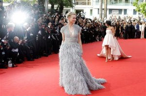 FILE - In this Wednesday, May 13, 2015 file photo, actress Naomi Watts, center, poses for photographers as she arrives for the opening ceremony and the screening of the film La Tete Haute (Standing Tall) at the 68th international film festival, Cannes, southern France. (AP Photo/Lionel Cironneau, File)