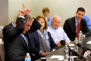 Former Florida Gov. Jeb Bush makes horns as he speaks about getting tough during a meeting with seacoast area business leaders, Wednesday, May 20, 2015, in Portsmouth, N.H. Bush is visiting the nation's earliest presidential primary state as he considers a run for the Republican nomination for president.  AP Photo/Jim Cole)