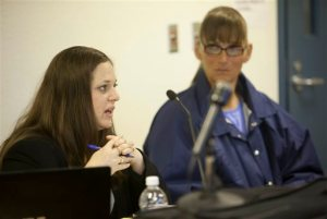 Inmate Michelle-Lael Norsworthy, right, listens to her attorney Kate Brosgart talk during her parole hearing at Mule Creek State Prison in Ione, Calif., Thursday, May 21, 2015. A federal judge ordered The California Department of Corrections and Rehabilitation to provide the transgender inmate with sex reassignment surgery, the first time such an operation has been ordered in the state. The parole board granted Norsworthy's request for parole which could change her possibility of surgery while in custody. (AP Photo/Steve Yeater)