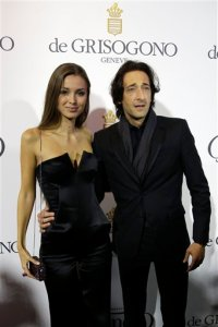Actor Adrian Brody, right, and partner  Lara Lieto pose for photographers upon arrival for the De Grisogono party at the Hotel du Cap-Eden-Roc, on the sidelines of the 68th Cannes international film festival, Cap d'Antibes, southern France, Tuesday, May 19, 2015. (AP Photo/Thibault Camus)