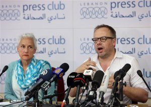 Reporters Without Borders secretary general Christophe Deloire, right, and Deborah Tice, mother of Austin Tice who is missing in Syria,  speak during a joint press conference, at the Press Club, in Beirut, Lebanon, Tuesday, May 19, 2015. Journalist Austin Tice, of Houston, Texas, disappeared in August 2012 while covering Syria's civil war. It's not clear what entity is holding him, but it is not believed to be the Islamic State group or the Syrian government, his family has said. (AP Photo/Bilal Hussein)