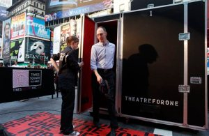 """FILE - In this June 7, 2011 file photo, an audience member steps out of the """"Theatre for One"""" performance space in New York's Times Square. Theatre for One, a 4-foot-by-8 foot portable theater, allows one audience member at a time to see one short play performed by a single actor. The theater will be parked in three Manhattan locations for the next two months, offering shows for free. Which show the audience sees is largely the luck of the draw, adding to this unique theatrical event. (AP Photo/Jason DeCrow, File)"""