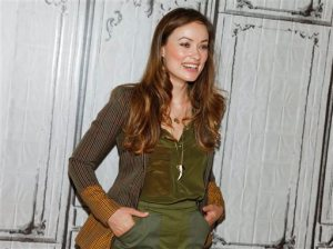 """FILE -In this April 17, 2015 file photo, Olivia Wilde participates in AOL's BUILD Speaker Series to discuss the film """"Meadowland"""" at AOL Studios in New York. Wilde is campaigning to remind the world that the Ebola crisis is far from over. The 31-year-old actress, who appeared in the TV medical drama """"House"""" and soon will be co-starring in the Christmas holiday comedy """"Love The Coopers,"""" came to the U.S. Mission to the United Nations on Tuesday, June 23, 2015, in a different role — as executive producer of the award-winning short documentary on Ebola """"Body Team 12."""" (Photo by Andy Kropa/Invision/AP, File)"""