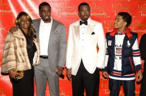 """FILE - In this Dec. 15, 2009 file photo, Sean Combs, second left, is joined by his mother Janice, left, and son Justin, right, as he unveils his wax figure at Madam Tussauds in New York. Sean """"Diddy"""" Combs was defending himself in an incident at the University of California, Los Angeles, that led to his arrest, a representative the hip-hop mogul's company said Tuesday, June 23, 2015. Diddy was arrested Monday for an alleged assault involving a weight-room kettlebell at the athletic facilities of UCLA, where his son, Justin Combs, plays football, a university statement said. (AP Photo/Charles Sykes, File)"""