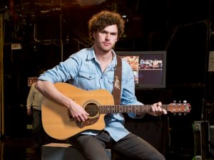 "In this April 14, 2015 photo, Australian singer-songwriter Vance Joy poses for a portrait in New York. Joy released his debut album, ""Dream Your Life Away,"" last year, and he recorded some vocals and drum tracks in a tree house at the studio of Ryan Hadlock, best known for his work with the Lumineers. (Photo by Drew Gurian/Invision/AP)"