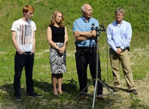 David Broomfield, 25, far left, Corinne Maleski and Andrew Broomfield, 38, stand next to their father, Thomas Broomfield, as he speaks about the recent death of his son, Keith Broomfield, who died while fighting with Kurdish forces against the Islamic State in Syria, on Thursday, June 11, 2015 in Bolton, Mass. (Christine Hochkeppel/Worcester Telegram & Gazette via AP)  MASSLIVE OUT