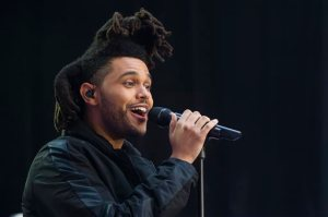 """FILE - In this May 7, 2015 file photo, Abel Tesfaye, known by his stage name The Weeknd, performs on NBC's """"Today"""" show in New York. The Weeknd and pop diva Beyonce will headline the Budweiser Made in America festival over Labor Day weekend in Philadelphia, it was announced Wednesday, June 24. Jay Z's two-day festival on Sept. 5 and 6 across Philadelphia's Benjamin Franklin Parkway will also include Axwell & Ingrosso, J. Cole, Bassnectar, Modest Mouse, Big Sean, Death Cab for Cutie and Meek Mill. Tickets go on sale Monday.  (Photo by Charles Sykes/Invision/AP, File)"""