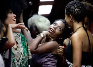 Contestants joke as they wait to walk on the catwalk during an Afro hair contest in Havana, Saturday, June 13, 2015. In a two-hour competition 70 women competed in three hair categories, natural, braided and dreadlocked. (AP Photo/Desmond Boylan)