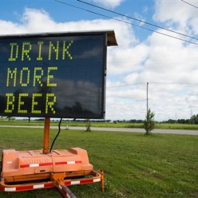 Road sign advising to 'drink more beer' sells for $600