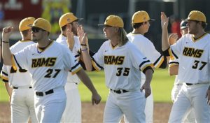 Virginia Commonwealth's Shane Dressler (27) Heath Dwyer (35) and Thomas Gill (37) celebrate the team's 5-1 win over Oregon State during an NCAA college baseball tournament regional game Sunday, May 31, 2015, in Dallas. (AP Photo/Ralph Lauer)