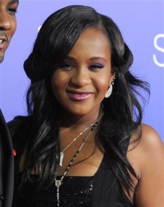 """FILE - In this Aug. 16, 2012, file photo, Bobbi Kristina Brown attends the Los Angeles premiere of """"Sparkle"""" at Grauman's Chinese Theatre in Los Angeles. Brown is moving to hospice care after months of receiving medical care. Pat Houston says in a statement Wednesday, June 24, 2015, that Whitney Houston's daughter's """"condition has continued to deteriorate. (Photo by Jordan Strauss/Invision/AP, File)"""