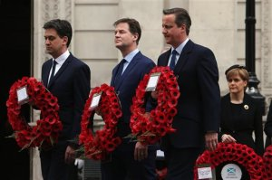 From left, Labour Party leader Ed Miliband, Liberal Democrat leader Nick Clegg and British Prime Minister David Cameron walk past First Minister of Scotland and leader of the Scottish National Party (SNP) Nicola Sturgeon to place a wreath during a tribute at the Cenotaph to begin three days of national commemorations to mark the 70th anniversary of VE Day, London, Friday, May 8, 2015. All of Britain's party leaders — both victors and losers — lined up together in central London to mark the 70th anniversary of Victory in Europe Day, holding wreaths of red poppies as they observed a moment's silence in honor of the fallen in World War II. (Dan Kitwood/Pool photo via AP)