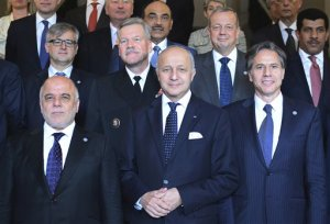 First row from left : Iraqi Prime Minister Haider al-Abadi, French Foreign Affairs Minister Laurent Fabius and US Deputy Secretary of State Antony J. Blinken pose for a group photo with Foreign Affairs ministers and members of the anti-Islamic State coalition after a meeting in Paris, France, to discuss strategy in fighting the jihadist militant group, who have made key battlefield advances in recent weeks in Iraq and Syria, Tuesday, June 2, 2015. Iraq's prime minister and international allies are gathering in Paris to re-examine their strategy against Islamic State extremists, after the group's recent gains. The coalition, which includes the United States and France but not Russia, Iran or Syria, is meeting Tuesday after extremists conquered both the Iraqi city of Ramadi and the historic Syrian city of Palmyra. (Stephane de Sakutin/Pool Photo via AP)