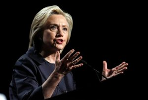 FILE - In this June 20, 2015, file photo, Democratic presidential candidate Hillary Rodham Clinton speaks at the U.S. Conference of Mayors 83rd Annual Meeting in San Francisco. Clinton is putting America's struggle with race relations at the forefront of her presidential campaign, joining with church members near the site of violent protests in Ferguson, Mo., Tuesday, June 23, 2015. (AP Photo/Mathew Sumner, File)