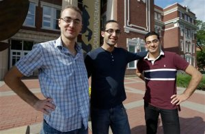 "Syrian brothers Mohammad Kayali, left, Ebrahim Kayali, right and Molham Kayali, center, pose for a photograph on the Emporia State University campus in Emporia, Kan., Wednesday, May 6, 2015.   Tens of thousands of college students in Syria have been displaced by the long-running conflict, creating an educational vacuum that colleges around the world are increasingly seeking to fill in the hopes that the ""academic refugees"" will someday help rebuild their country. Brothers, Molham, Mohammad and Ebrahim Kayali all landed at Emporia State University in Kansas and are emblematic of the plight and are among the 700 Syrian students in the U.S. (AP Photo/Orlin Wagner)"