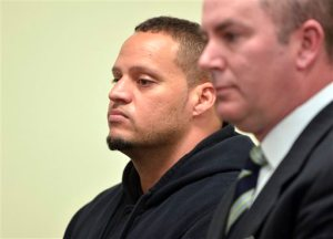 FILE - In this Feb. 26, 2014, file photo, Hugo Hesny, left, a security guard for pop singer Justin Bieber, stands beside his lawyer Andrew Schwartz during an appearance in Fulton County Magistrate Court in Atlanta. Hesny, 33, was ordered Tuesday, June 23, 2015, to serve 45 days in jail. Hesny told police he took a camera from a photographer. Under a deal reached with prosecutors, he pleaded no contest last week to two misdemeanor counts of disorderly conduct, according to court records. (AP Photo/Atlanta Journal-Constitution, Kent D. Johnson, File)