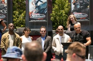"Vin Diesel, right, speaks at the World Premiere of the ""Fast & Furious-Supercharged"" ride at Universal Studios Hollywood on Tuesday, June 23, 2015, in Universal City, Calif. (Photo by John Salangsang/Invision/AP)"