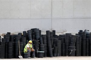 """A worker takes a break at the construction site of the Stavros Niarchos Culture Center where the new opera house and national library will be completed in 2016, in southern Athens, on Monday, June 8, 2015. The 566-million euro project is one of the country's few privately funded projects since the country was struck by a major financial crisis in 2009. Greek negotiators are in Brussels to explore the """"scope for convergence"""" with the country's creditors, following days of acrimony over rival reform proposals for a deal that will unlock Greece's last remaining bailout funds. (AP Photo/Thanassis Stavrakis)"""