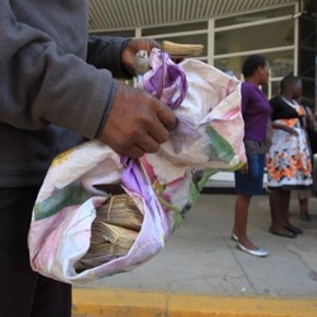 Zimbabweans trade in old currency for peanuts